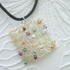 So pretty. Knitted Silver Wire Pendant Necklace  Soft Colors by AcornSilver