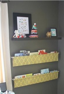 curtain rods and fabric bookshelves. LOVE.