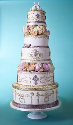 Very ornate lilac and gold wedding cake