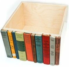 old book spines glued to a box . hidden bookshelf storage . upcycled.