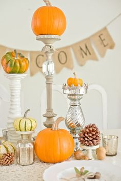 Fall Tablescape - love the pumpkins on candleholders!