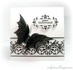 handmade halloween card from crafticious ... elegant black and white ... black die cut butterfly with black on black embossing ... elegant butterfly look flourish band ... great card!!