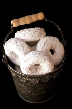 A lovely vintage pail full of (baked, not fried) Whole Wheat Powdered Sugar Donuts. #powdered_sugar #baked #doughnuts #food #cooking #dessert #baking #treats #breakfast #snack