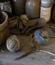Early homespun rag balls, wood spoons and crocks.