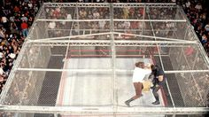 Mankind aka Mick Foley battles The Undertaker atop the cell at King of the Ring 1998, moments before taking the most replayed bump in pro wrestling history.