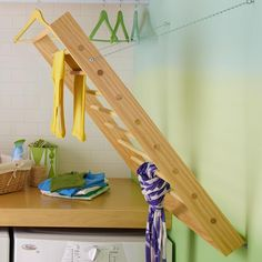 Build and attach a pullout rack for drying delicate and hand-washed items. #DIY
