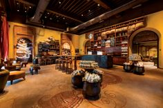 Located in the historic Elphinstone Building in Mumbai, this store marked the beginning of Starbucks journey in India. It is designed to reflect Starbucks coffee heritage and embrace the local culture, with the artifacts, Indian teakwood furniture, floor design, and interiors created by local craftsmen and artists. interior, mumbai, coffe shop, espresso, floor design, coffee, store design, india, starbucks