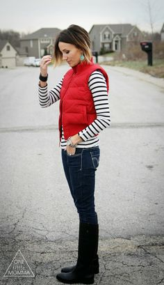 Pair a bright puffy vest with stripes, dark denim and tall boots