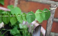 Sew leaves as garland for fairy garden