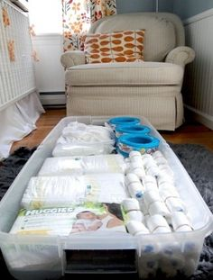 Utilize under-crib space with big storage boxes for extra diapers, wipes, and more. I have no idea why I never considered this.