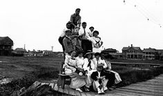 A group of people gathered around the Norwegian Lady, a figurehead from the Norwegian barque Dictator, located at 16th Street on the Virginia Beach oceanfront boardwalk - Virginia Beach. (Date: About 1900s-1910s).