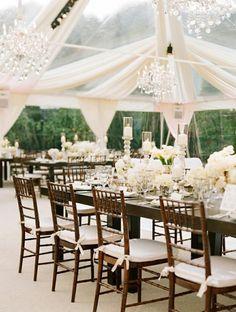 Drape + chandelier... a gorgeous combination.