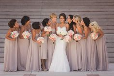Love the muted bridesmaid's colors with the pop of color using flowers... this pose is adorable too!! bridesmaids colors, wedding dressses, color schemes, bridesmaid dresses, bridesmaid colors, the dress, the bride, bridesmaids champagne dress, nude bridesmaid dress