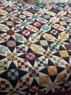 "Another pinner said: This wonderful quilt was pieced by my Mother in Law, and quilted by her Quilting Bee in Graham, Texas.  It was an exchange block of 3"" nine patches, and she made this great star quilt by adding a simple triangle patch.  Amazing!  What a treasure."