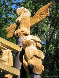 Eagle, beaver and owl totems at the T. Dawson Brown Gateway; carved by Alan Fontana.  At Camp #Yawgoog, Rockville, Hopkinton, Rhode Island (RI).  A 2014 image by David R. Brierley.