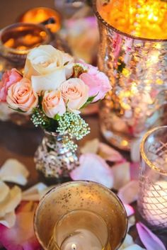 Glimmering candles and sweet pastel roses add romance to the table décor. Coordination and design by Kate Whelan Events.