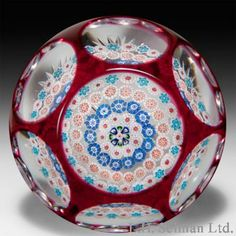 Baccarat (antique) Paperweight ruby flash overlay spaced concentric millefiori.