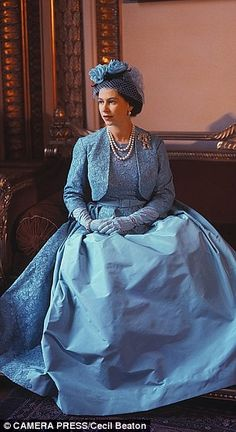 The Queen at Princess Margaret's wedding in 1960.  Norman Hartnell dress.  Look closely and you will see the Lover's Knot brooch - the same one she wore to William and Kate's wedding in 2011.