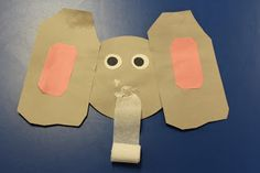 Integrating Math :  elephant with 6 ft. crepe paper trunk (Mrs. Lee's zoo unit)