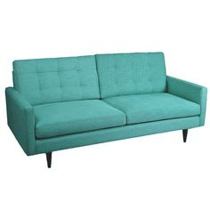 Linen-upholstered teal sofa with button tufting and a midcentury-inspired design.