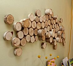 earthy & easy to DIY, found via: http://www.curbly.com/users/capreek/posts/10569-how-to-turn-logs-into-affordable-wall-art