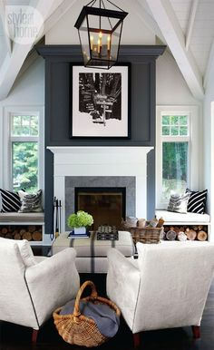 living rooms - vaulted ceiling blue fireplace wall built-in window seats iron lantern French grain sack ottoman bench Amazing living room with