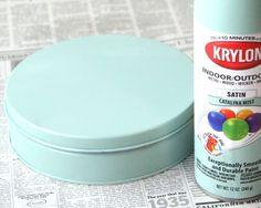Spray painting tins.