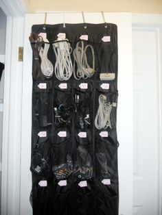 Absolutely love this idea of using an over-the-door shoe organizer to corral assorted cords, batteries, etc.  I've got a closet that is in *serious* need of a good organization makeover.