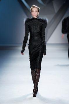 Dark green vault jacquard long sleeve sheath dress with oversized charcoal raccoon detachable hood.