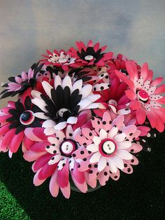 So cute! We could mix and match gerber daisy colors and add black dots. These are centerpieces but you could do this same idea with bridesmaid bouquets or your own (if the flowers are fake)