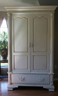 Annie Sloan Old White Chalk Paint, distressed and finished with Annie Sloan Clear Wax and Dark Wax ....cabinets?