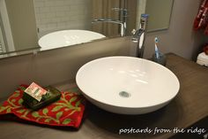 Angie of Postcards from the Ridge renovated her 1960s bathroom using our products, including this gorgeous Decolav sink and American Standard faucet. Click the photo to see more!