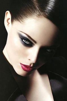 Double the dramatic with thick black eye shadow and a bold red lip.