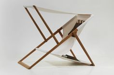 XZ beach chair by Numen, a traditional deck chair with removable sunshade.
