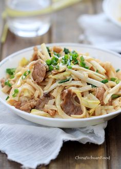 Beef chow fun-stir-fried beef with rice noodles.