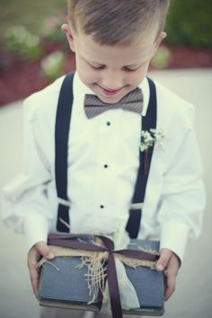 ring bearer. love the idea of a book! And LOVE the outfit! Perfect to match the groomsmen.