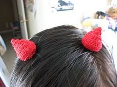Add the perfect finishing touch to your Halloween costume this year with these Devil Horn Hair Clips. This easy crochet pattern is an inexpensive way to complete your outfit. It's hard not to have a sinfully good time when you look this good.