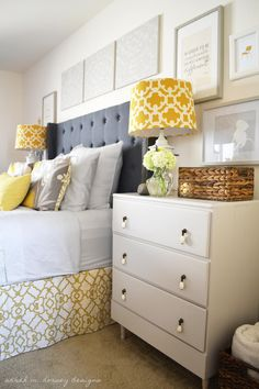 white, gray  yellow bedroom with tufted headboard and chests in lieu of headboards