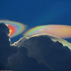 Fire rainbow cloud: The rare phenomenon appeared behind a storm cloud near Delray Beach, Florida