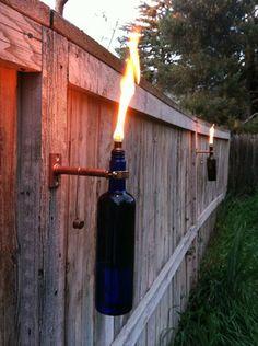 Wine bottle tiki torches