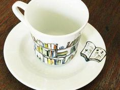 Coffee or Tea cup with matching Book-themed saucer.