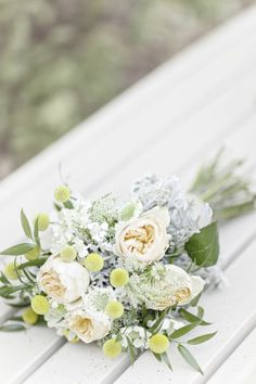Peach garden roses, billy buttons, and dusty miller | Photo by Glass Jar Photography