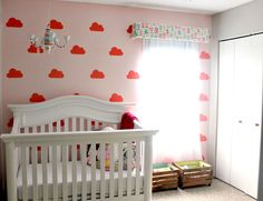 This cloud wall done with stencils has us on Cloud Nine! #babygirl #nursery