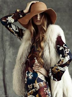 vintage floral print dress, fur vest, floppy hat.
