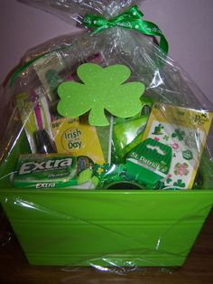 All Things Green gift basket for my Secret Pal at church to celebrate St. Patrick's Day.  Green nail polish, emery boards, pocket tissues, cucumber facial masks, gum, mints, socks, shamrock necklaces and other green whatnots.