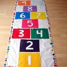 DIY Indoor Hopscotch Mat {No-Sew} OH MY! GOTTA DO THIS!  K, so felt, white canvas, hot glue , that's it!