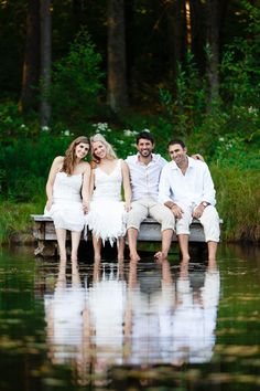 Lake picture with bride, groom, best man, and maid of honor
