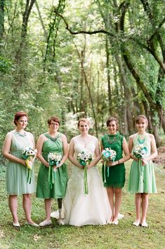 bridesmaids in shades of green, photo by White Rabbit Studios http://ruffledblog.com/verdant-alabama-wedding #bridesmaiddresses