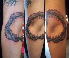 Jaw tattoo framing elbow <3