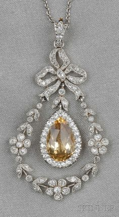 Edwardian Topaz and Diamond Pendant, Black, Starr & Frost, set with a faceted topaz measuring approx. 12.00 x 7.00 x 5.40 mm, framed by an old mine-cut diamond melee garland, surmounted by a bow, lg. 1 3/4 in., signed B.S, and suspended from platinum chain. woman fashion, fashion ideas, weight loss, chains, diamond pendant, bows, yellow diamonds, diamond necklaces, black